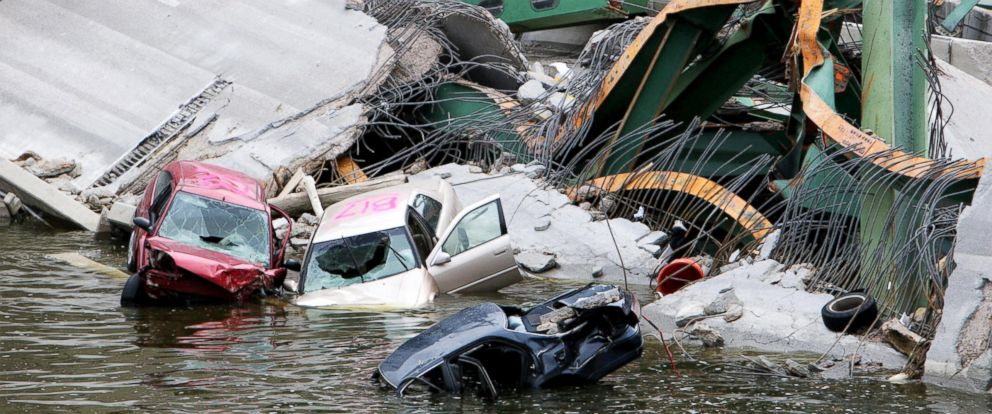 PHOTO: Cars are seen on the collapsed I-35W bridge in Minneapolis, Minnesota, Aug. 4, 2007.