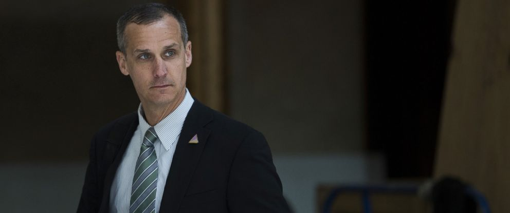 PHOTO: Corey Lewandowski, campaign manager for 2016 Republican presidential candidate Donald Trump, listens as Trump speaks at the Trump International Hotel Washington DC in Washington, D.C., U.S., March 16, 2016.