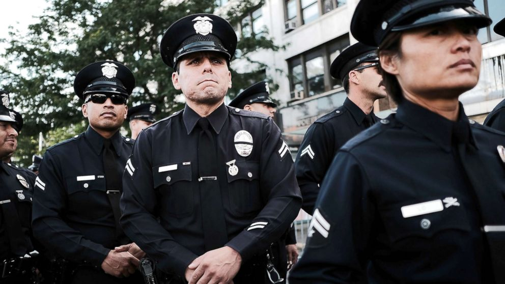 "Police from Los Angeles stand outside of a Bronx church during the funeral for NYPD Officer Miosotis Familia, who was shot and killed last week in what police have called ""an unprovoked attack"" in the Bronx, on July 11, 2017, in New York City. Thousands of police officers from around the country have joined local politicians and community leaders for the funeral of Officer Familia, 48, who was shot last Wednesday as she sat in an NYPD mobile command vehicle at 183rd St. and Creston Ave. in Fordham Heights."
