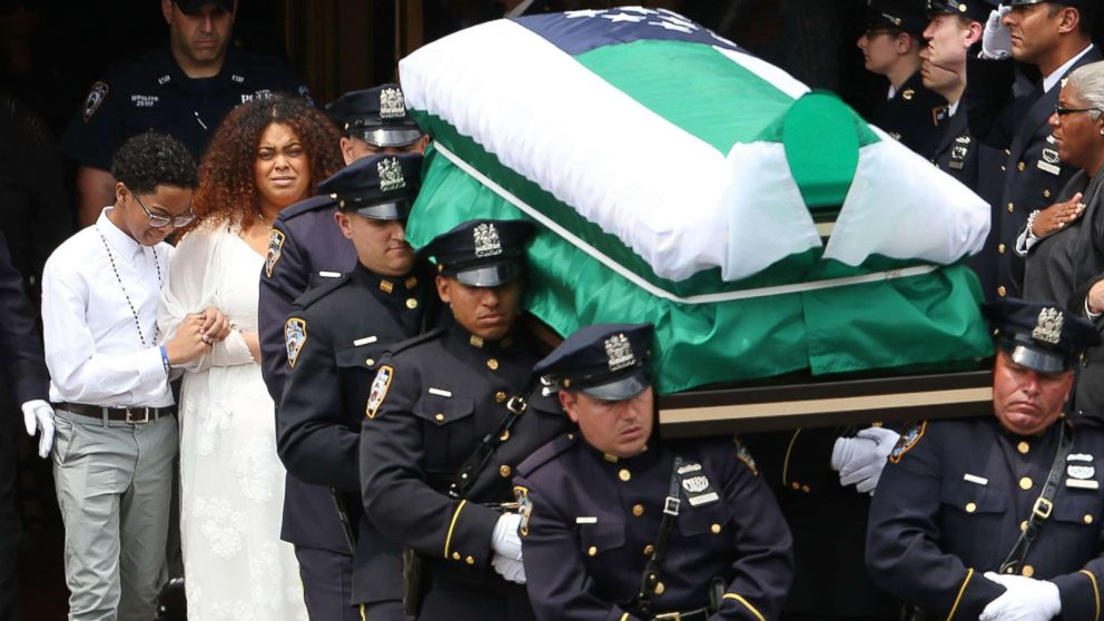 "The casket of fallen NYPD Officer Miosotis Familia is brought outside of a Bronx church after she was shot and killed last week in what police have called ""an unprovoked attack"" in the Bronx, on July 11, 2017, in New York City. Thousands of police officers from around the country have joined local politicians and community leaders for the funeral of Officer Familia, 48, who was shot last Wednesday as she sat in an NYPD mobile command vehicle at 183rd St. and Creston Ave. in Fordham Heights."