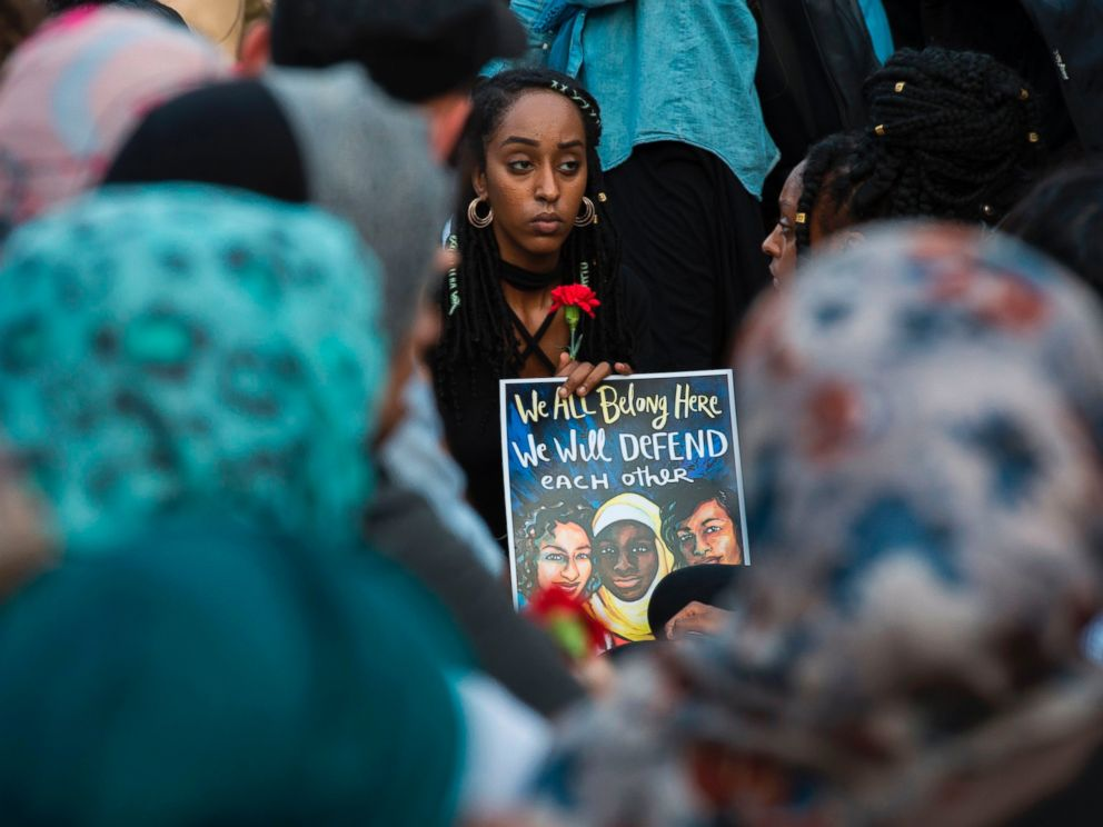 PHOTO: People hold up signs during a vigil in Washington, on June 20, 2017, for Nabra Hassanen, a 17-year old Muslim girl that was killed in a road rage incident on June 18.