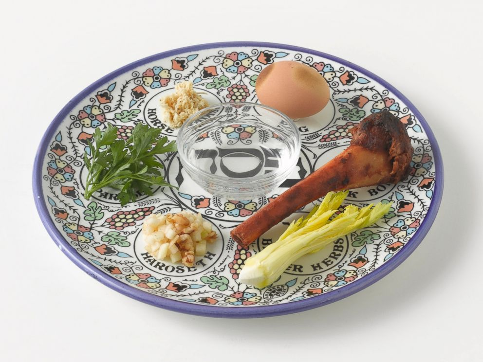 PHOTO: A Passover Seder of roasted egg, roasted bone, parsley, charoset, celery, nuts and salt water on a plate.