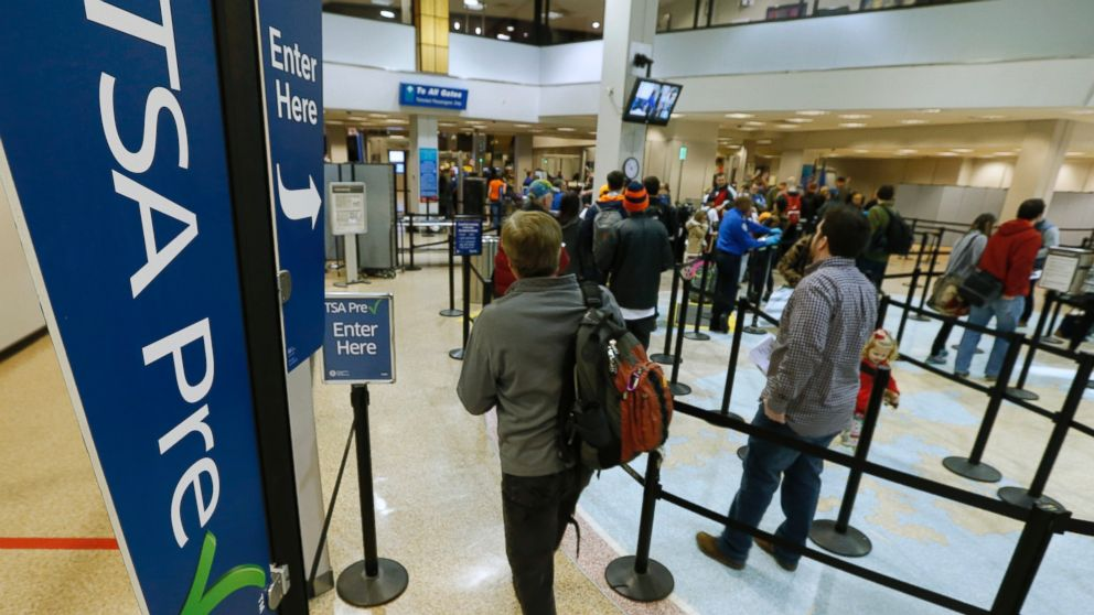 A passenger enters the Transportation Security Administration (TSA) pre-check line towards a security check point at Salt Lake City International Airport in Salt Lake City, on Dec. 23, 2014.