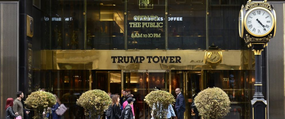 PHOTO: New York City shoppers and visitors walk past the entrance to Trump Tower on Fifth Avenue, a mixed use skyscraper owned by Donald Trump, April 26, 2015.