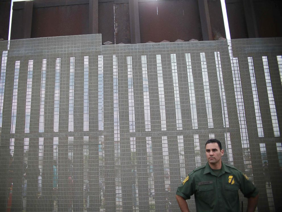 PHOTO: A US Customs and Border Agent standing a post along the United States-Mexico Border at Friendship Park in San Ysidro, Calif., November 19, 2016. <p itemprop=