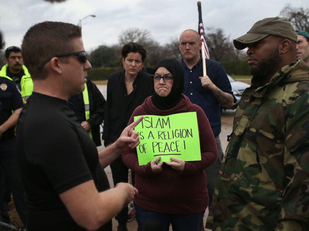PHOTO: Protest leader David Wright, from the so-called Bureau of American-Islamic Relations (BAIR), speaks with a counter-demonstrator in front of the Islamic Association of North Texas at the Dallas Central Mosque, Dec. 12, 2015, in Richardson, Texas.