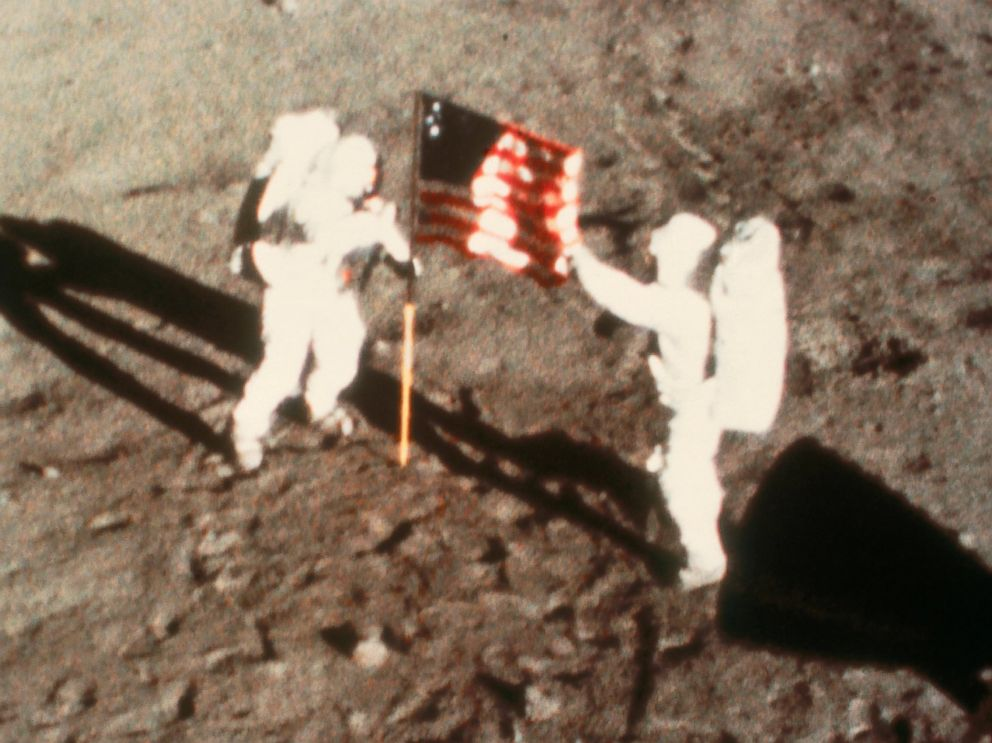 PHOTO: Astronauts Neil Armstrong and Edwin Aldrin climb down from Apollo 11 to become the first humans to set foot on another planetary body, 20 July 1969.