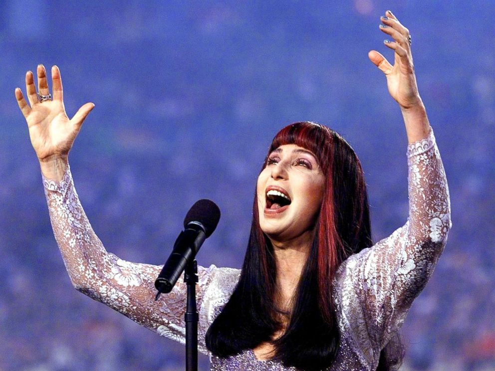 PHOTO: Cher sings the Star Spangled Banner before the start of Super Bowl XXXIII, Jan. 31, 1999, at Pro Player Stadium in Miami.