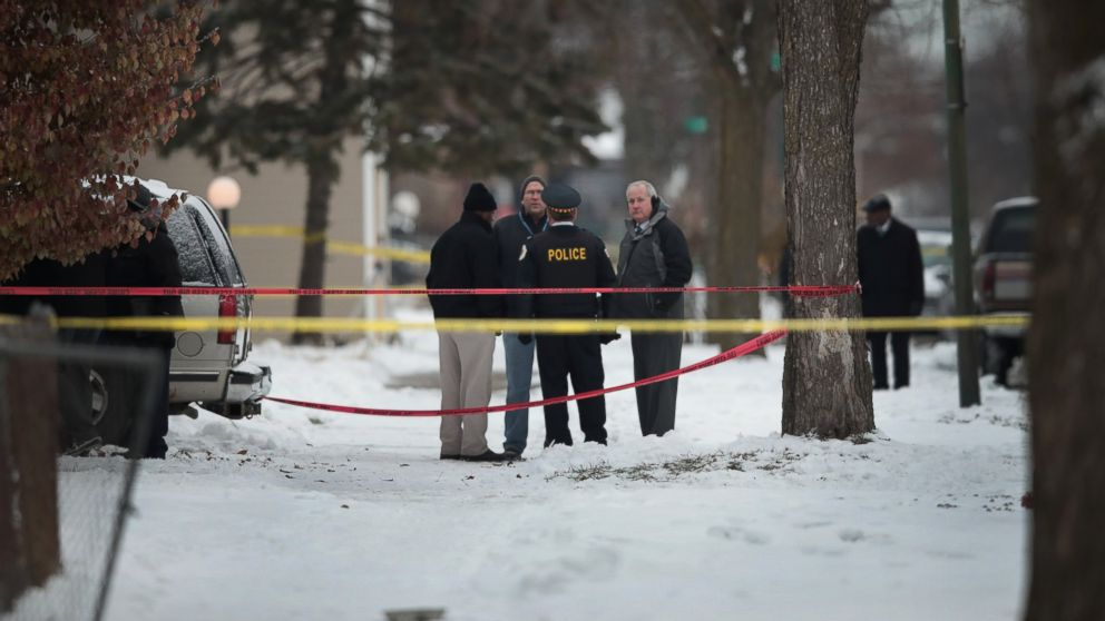 Police investigate the scene of a quadruple homicide on the city's Southside, Dec. 17, 2016 in Chicago. Three people were found shot to death inside a home in the Fernwood neighborhood, another 2 were found shot outside the home, one of those deceased. Chicago has had more than 750 homicides in 2016.