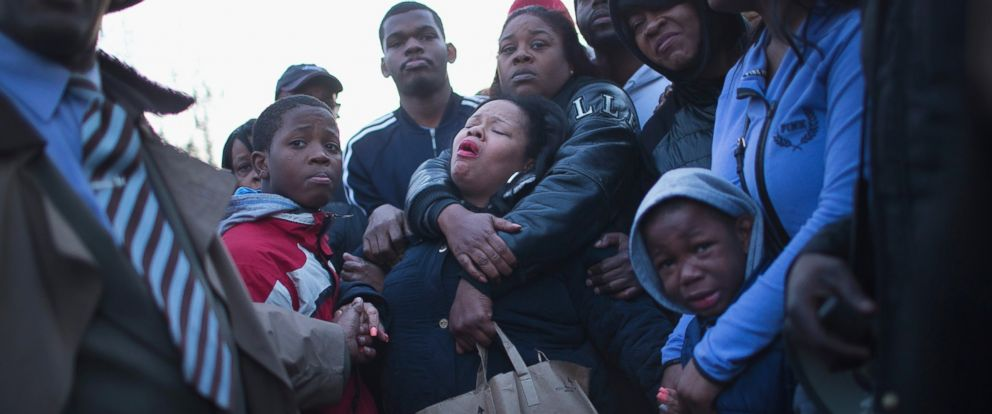 PHOTO: Tambrasha Hudson (C) is comforted as she joins demonstrators protesting the shooting death of her son 16-year-old Pierre Loury near the location where he was killed on April 12, 2016 in Chicago.