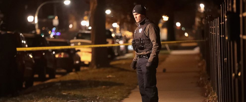 PHOTO: Police investigate the scene of a shooting where a 23-year-old woman was shot in the chest and hand and a 25-year-old man was shot in the leg, Jan. 1, 2017 in Chicago.