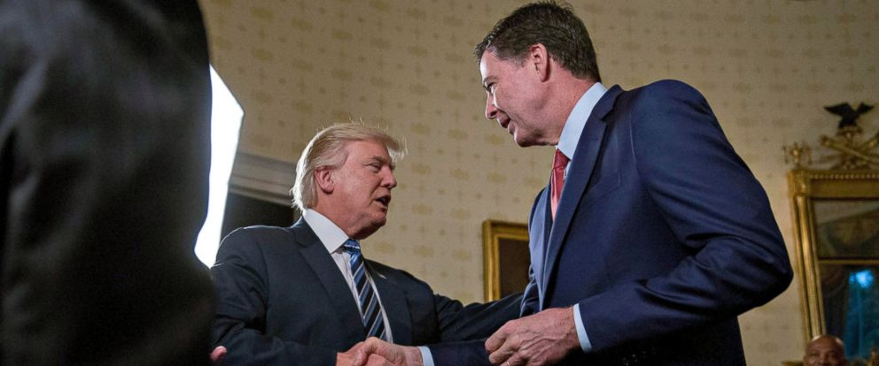 PHOTO: President Donald Trump shakes hands with James Comey, director of the Federal Bureau of Investigation, during an Inaugural Law Enforcement Officers and First Responders Reception in the Blue Room of the White House, Jan. 22, 2017, in Washington.