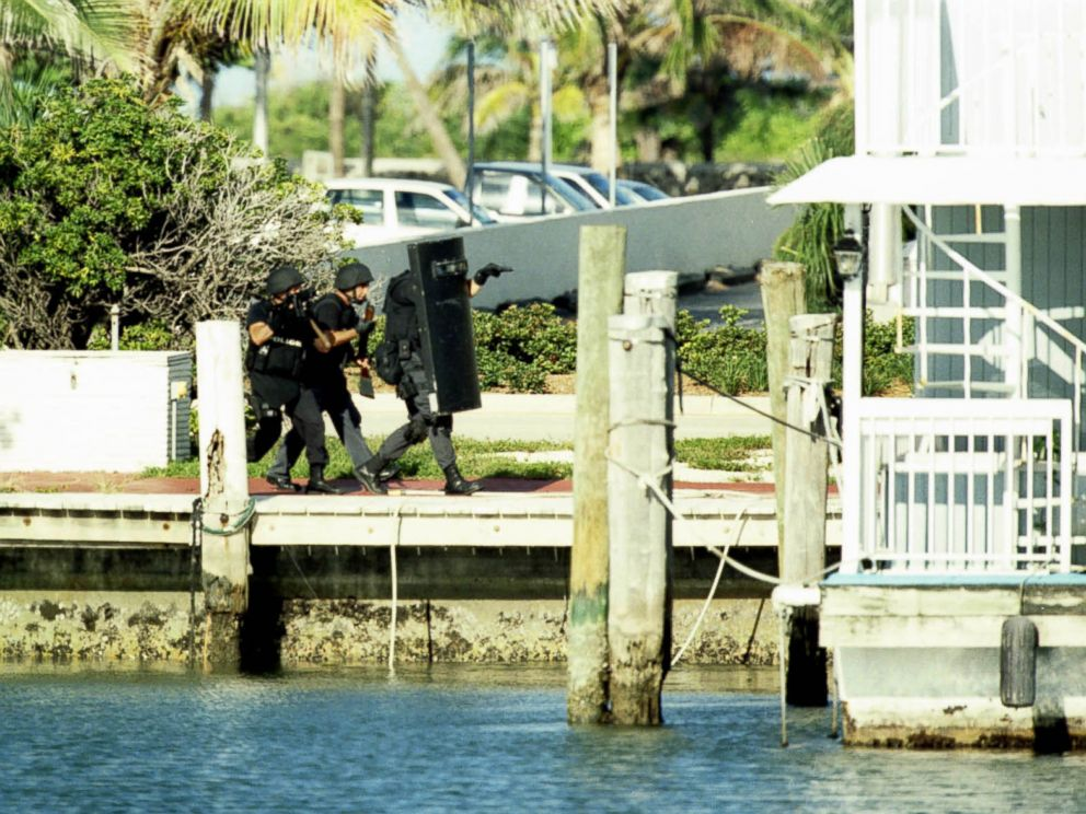 PHOTO: Members of the Miami-Dade Swat team storm a Miami Beach boat house containing serial killer Andrew Cunanan, July 23, 1997.