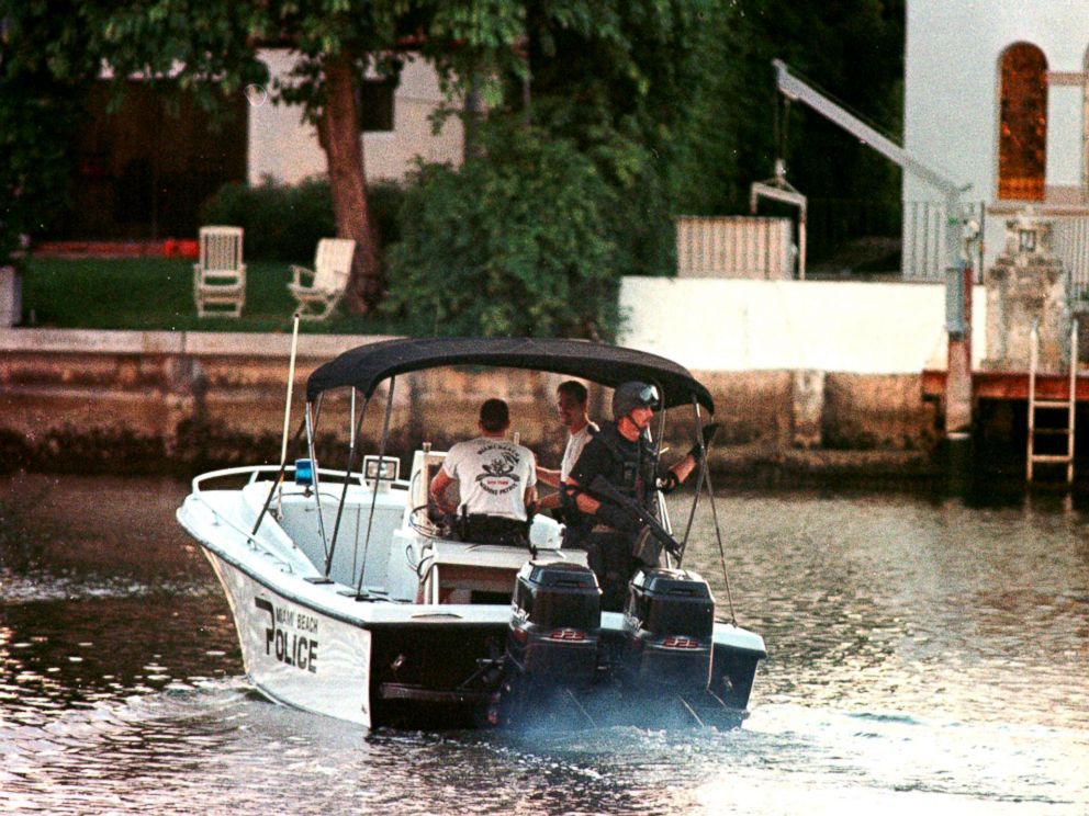 PHOTO: A member of the Miami Beach police SWAT team patrols a canal in the vicinity of a houseboat in Miami Beach, Fla., July 23, 1997, after it was reported that an unknown person was seen inside by the houseboats caretaker.