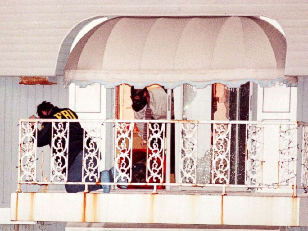 PHOTO: Miami Beach police and FBI agents examine the balcony of a houseboat that was stormed by a police SWAT team on a canal in Miami Beach, July 23, 1997.