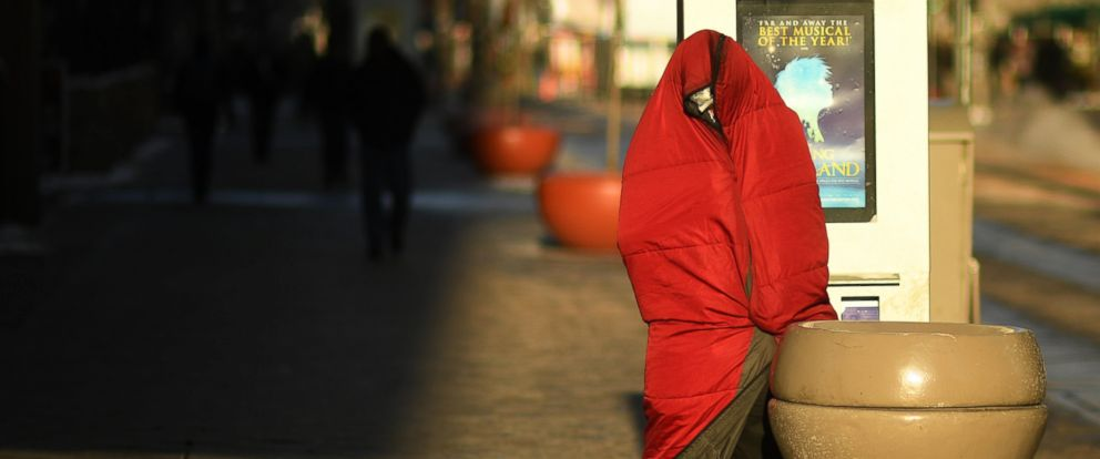 PHOTO: A homeless man tries to stay warm in frigid temperatures in Denver, Dec. 8, 2016.