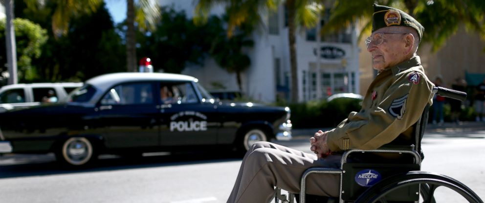 PHOTO: Morris Brama, a 99-year-old U.S. Army World War II veteran, watches the parade go past during the Miami Beach Veterans Day Ceremony, Nov. 11, 2014 in Miami Beach, Florida.