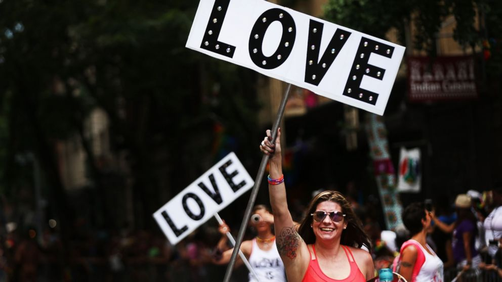 Participants in the annual New York Gay Pride Parade march in the West Village in Manhattan, June 25, 2017 in New York City.