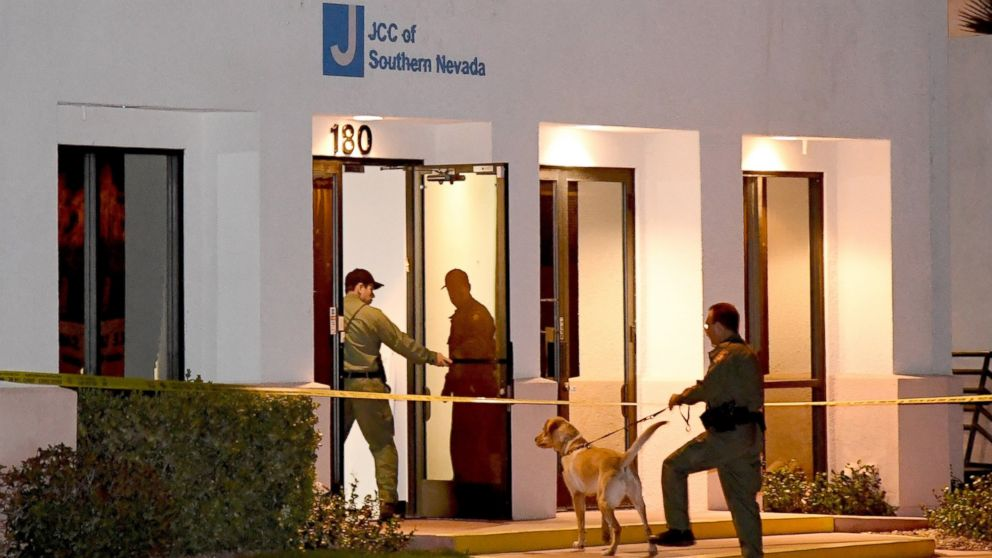 Las Vegas Metropolitan Police Department K-9 officers search the Jewish Community Center of Southern Nevada after an employee received a suspicious phone call that led people to evacuate the building, Feb. 27, 2017, in Las Vegas, Nevada.