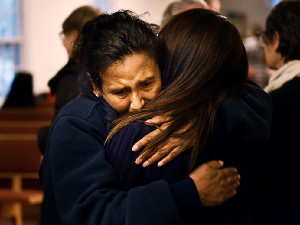 PHOTO: Jeanette Vizguerra hugs her friend Ingrid Encalada Latorre after Latorre announces her claim of Sanctuary at a Mountain View Friends Meeting.