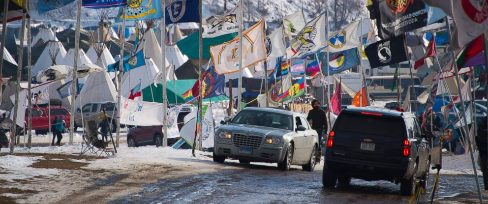 PHOTO: Flags flap in the wind on the main thoroughfare of Oceti Sakowin Camp on the edge of the Standing Rock Sioux Reservation, Dec. 3, 2016 outside Cannon Ball, North Dakota.