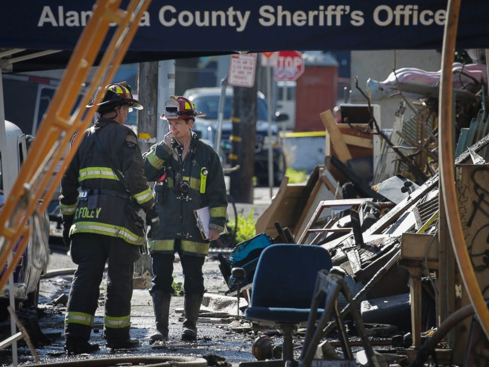 PHOTO: Firefighters work on the scene following an overnight fire that claimed the lives of at least nine people at a warehouse in the Fruitvale neighborhood, Dec. 3, 2016 in Oakland, California.