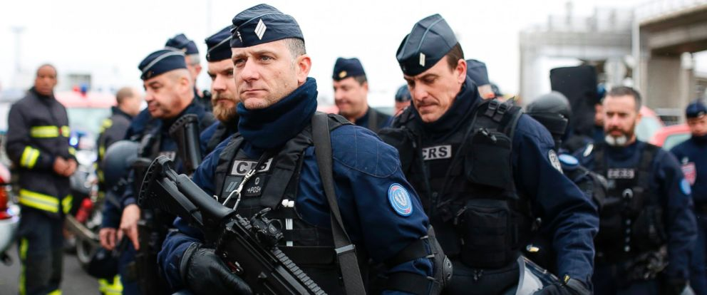 PHOTO: French policemen secure the area at the Paris Orly airport on March 18, 2017 following the shooting of a man by French security forces.