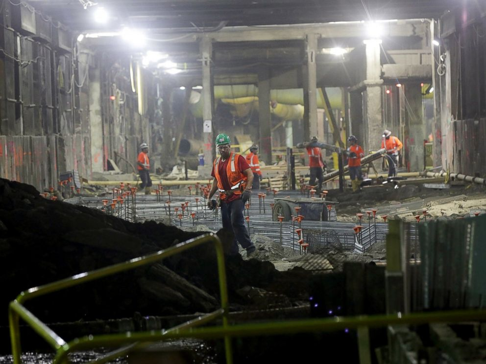 PHOTO: Workers stand in a tunnel in the East Side Access project, one of the largest transportation infrastructure projects currently underway in the United States, Nov. 4, 2015, in New York City.