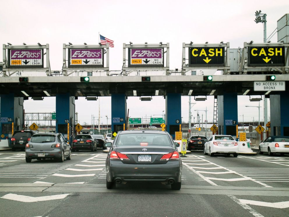 PHOTO: Cars queue at a toll plaza on the Robert F. Kennedy bridge in New York.