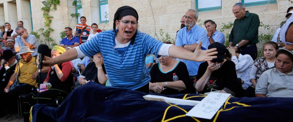 PHOTO: Israeli Rina Yaffa Ariel, mourns over the body of her daughter Hallel, a 13-year-old girl who was fatally stabbed by a Palestinian attacker in her home, during her funeral in the Kiryat Arba, Israeli, on June 30, 2016.