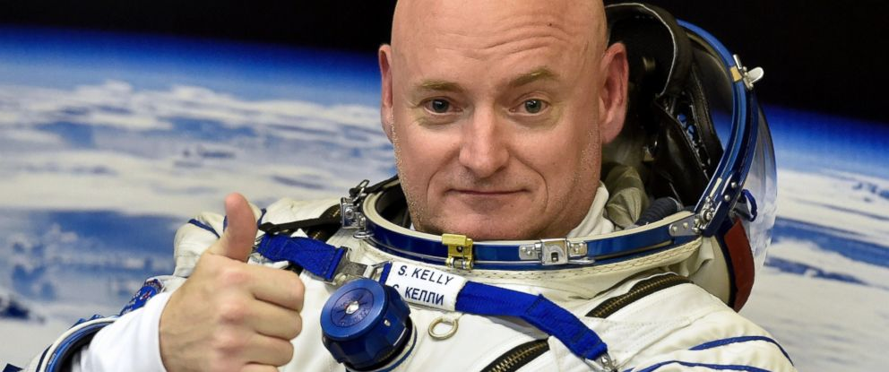 PHOTO: US astronaut Scott Kelly gestures as his space suit is tested at the Russian-leased Baikonur cosmodrome, prior to blasting off to the International Space Station (ISS) on March 27, 2015.