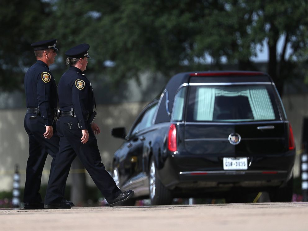 PHOTO: Police officers arrive at a funeral service for slain Dallas Area Rapid Transit (DART) police officer Brent Thompson at the Potter House Church on July 13, 2016 in Dallas.