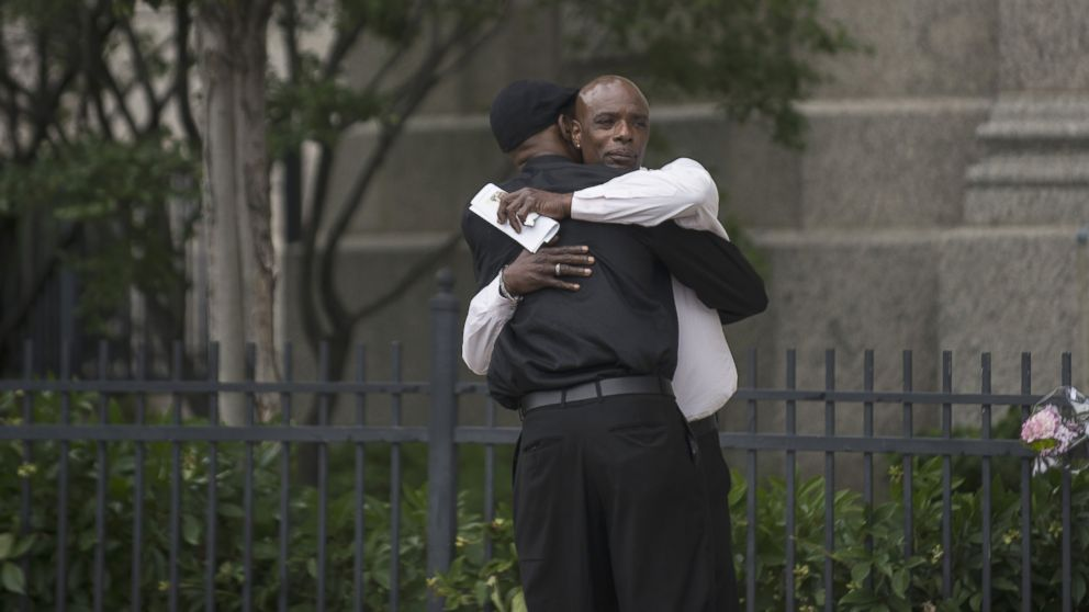 Two men embrace outside the funeral of Philando Castile at the Cathedral of St. Paul, on July 14, 2016, in St. Paul, Minnesota.
