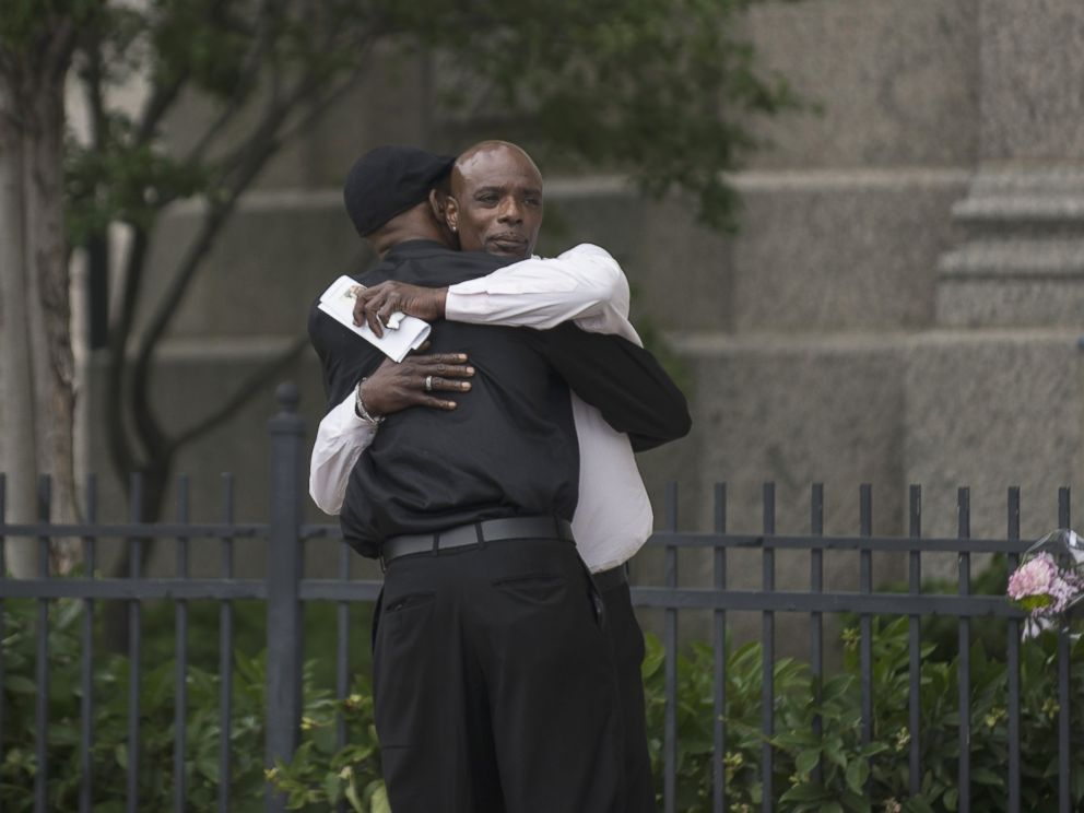 PHOTO: Two men embrace outside the funeral of Philando Castile at the Cathedral of St. Paul, on July 14, 2016, in St. Paul, Minnesota.