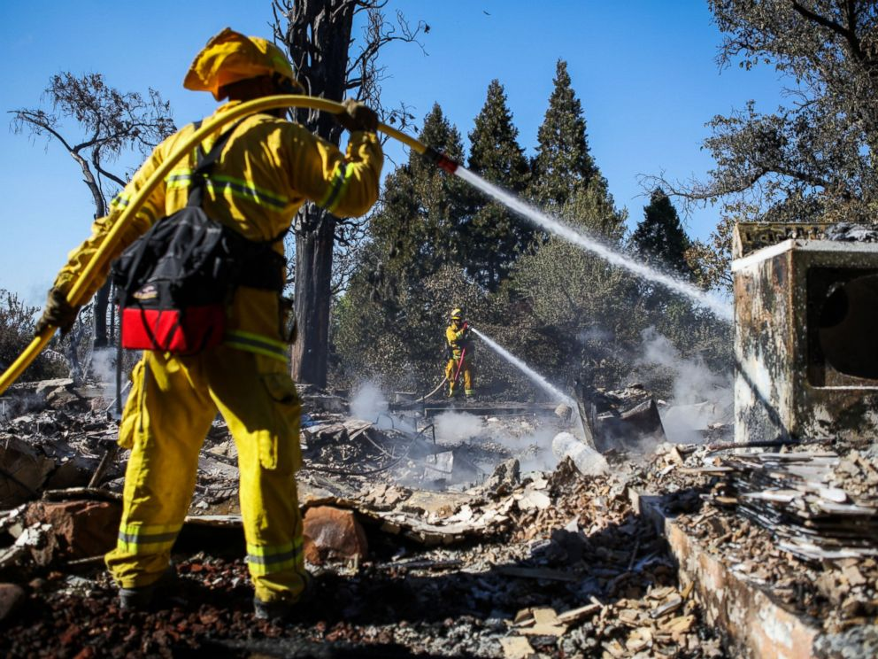PHOTO: A firefighter works to contain embers on the remains of a house destroyed in the Clayton Fire are seen in Lower Lake, California, Aug. 15th, 2016.