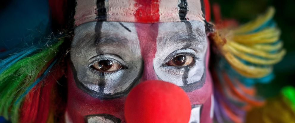 PHOTO: A clown poses for a photograph before a performance on October 17, 2015.