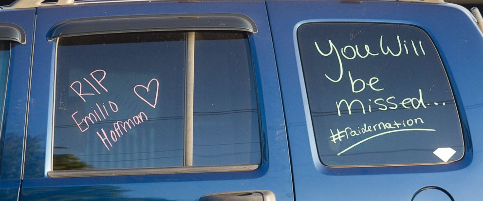 """PHOTO: A students car bears the message to """"RIP Emilio Hoffman"""" as its parked near a church holding a vigil to pray for the victims of todays school shooting, June 10, 2014, in Gresham, Oregon."""
