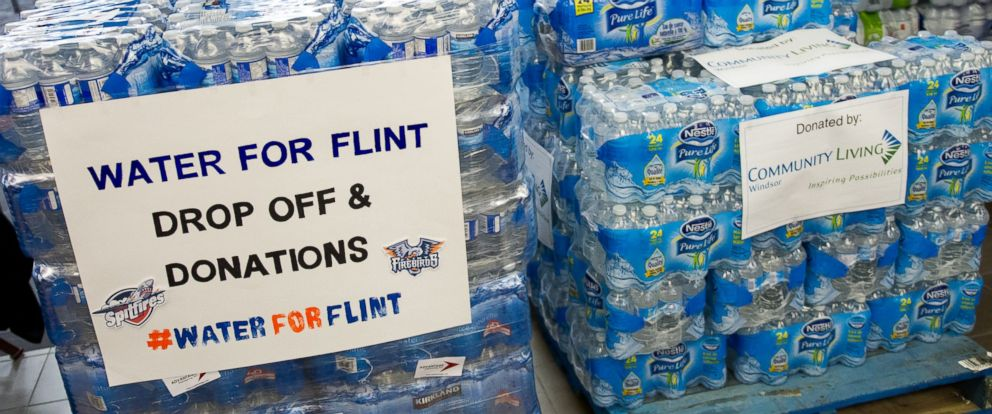 PHOTO: Fans bring in donations of bottled water prior to the game between the Flint Firebirds and the Windsor Spitfires on Jan. 21, 2016 at the WFCU Centre in Windsor, Ontario, Canada.