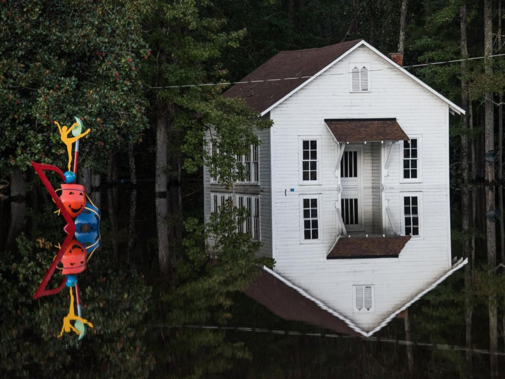 PHOTO: A building is inundated with floodwaters on Oct. 10, 2016, in Lumberton, North Carolina.