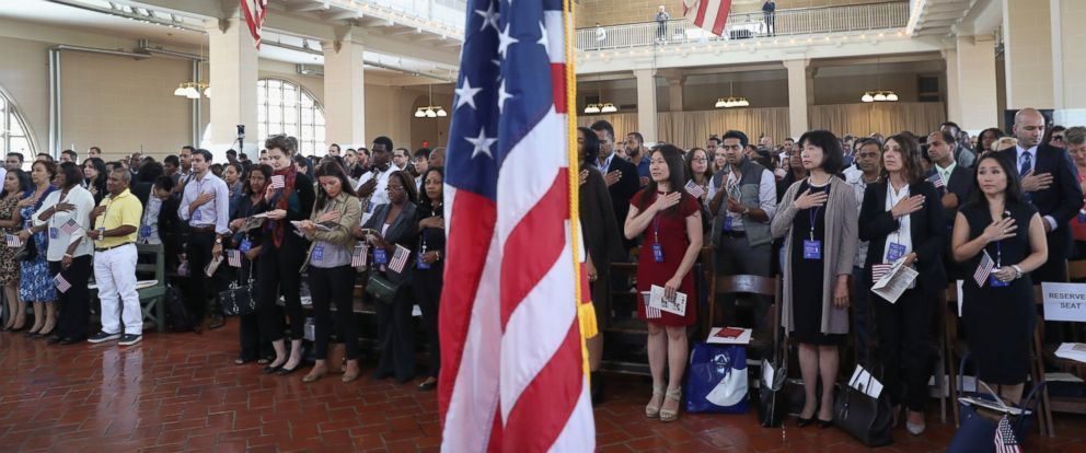 PHOTO: Immigrants take part in a naturalization ceremony in the Great Hall of Ellis Island on September 16, 2016 in New York City.