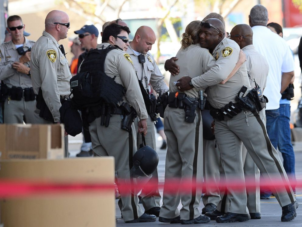 PHOTO: Las Vegas Metropolitan Police Department officers hug near a Wal-Mart on June 8, 2014 in Las Vegas, Nevada. Two officers were reported shot and killed by two assailants at a pizza restaurant near the Wal-Mart.
