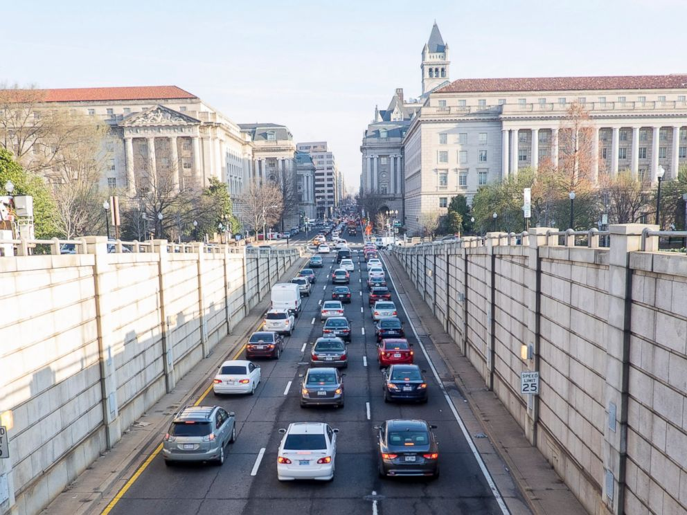 PHOTO: Commuters stream into the city on 12th St NW during the morning rush hour on March 16, 2016 in Washington, DC. The area Metro train system was shut down for 29 hours for a safety inspection after a recent fire.