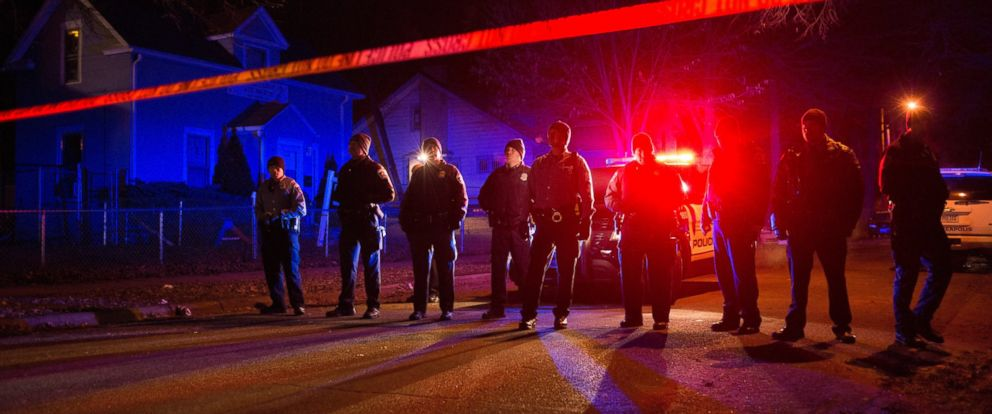 PHOTO: Police line up in front of a crime scene, Nov. 24, 2015, in Minneapolis.
