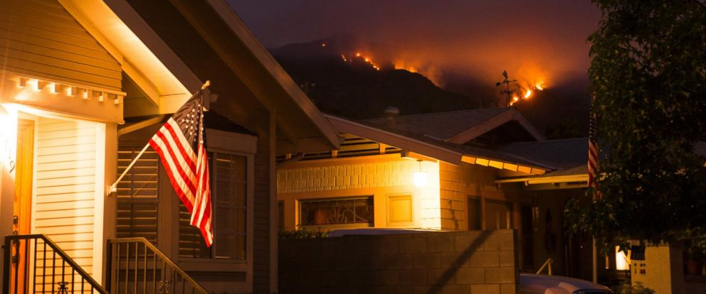 PHOTO: Smoke and flames from the San Gabriel Complex Fire are seen at nightfall from a residential street in Monrovia, Calif., on June 21, 2016.