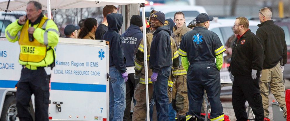 PHOTO: EMS workers gather at a staging area by Excel Industries in Hesston, Kan., where a gunman reportedly killed up to seven people and injured many others on Feb. 25, 2016.