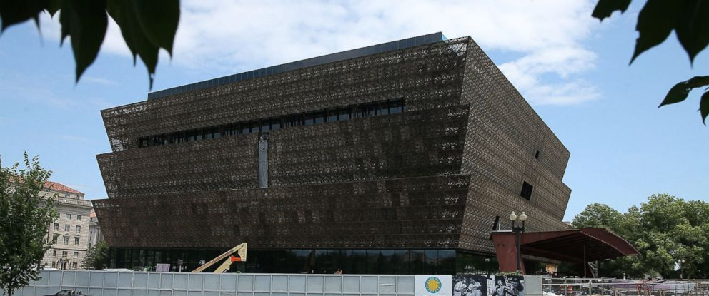 PHOTO: Tourists walk past the Smithsonian Museum of African American History and Culture that is currently under construction, July 16, 2015 in Washington.