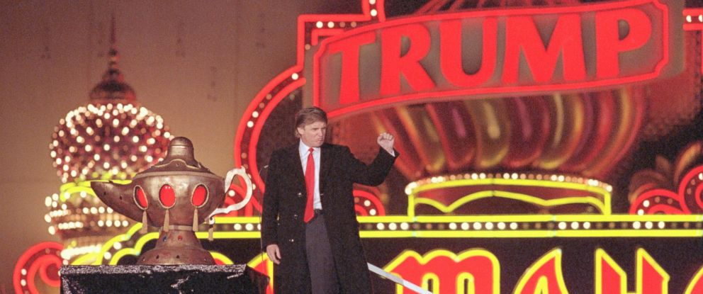PHOTO: Donald Trump raises his fist in a salute as he presides over opening ceremonies of the formal opening of his Taj Mahal in Atlantic City, New Jersey, which he calls the 8th wonder of the World.