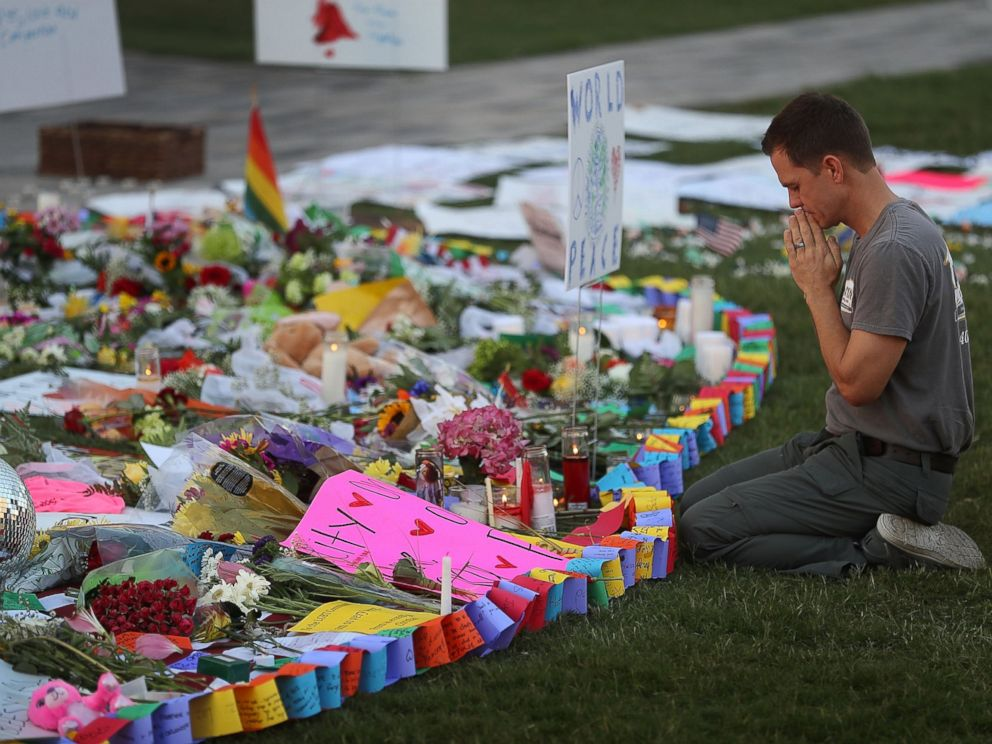 PHOTO: Matt Mitchell pays his respects at a memorial in front the Dr. Phillips Center for the Performing Arts to the victims of the Pulse gay nightclub shooting where Omar Mateen allegedly killed 49 people on June 14, 2016 in Orlando, Florida.