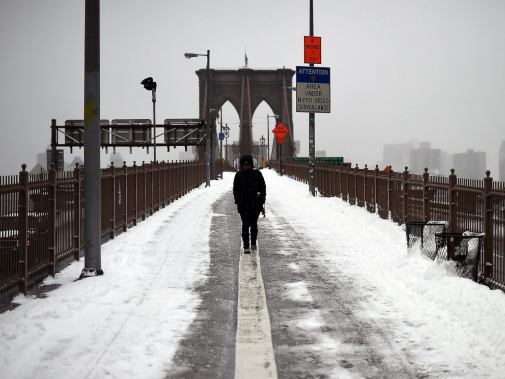 PHOTO: A woman walks on the Brooklyn Bridge in New York after a snowstorm on January 27, 2015. A blizzard initially billed as possibly one of the worst ever in New York left only moderate snow in the Big Apple.