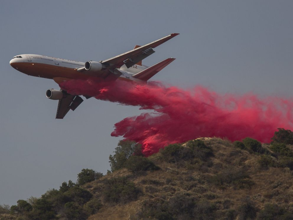 PHOTO: A converted DC-10 Air Tanker drops fire retardant along a ridge to protect communities that border the wilderness at the San Gabriel Complex Fire in the Angeles National Forest on June 21, 2016 near Monrovia, Calif.